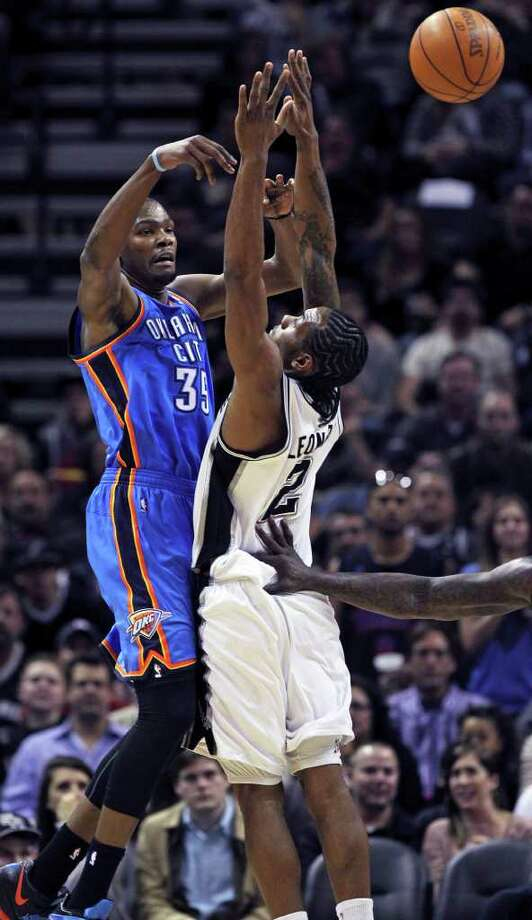 Thunder forward kevin Durant is forced to pass by tough defensive applied by Kawhi Leonard as the San Antonio Spurs play the Oklahoma City Thunder at the AT&T Center  on February 4, 2012 Tom Reel/ San Antonio Express-News Photo: TOM REEL, Express-News / San Antonio Express-News