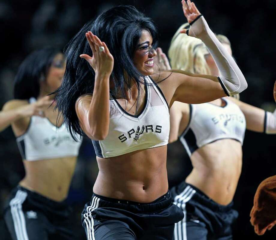 The Silver dancers perform as the San Antonio Spurs play the Oklahoma City Thunder at the AT&T Center  on February 4, 2012 Tom Reel/ San Antonio Express-News Photo: TOM REEL, Express-News / San Antonio Express-News