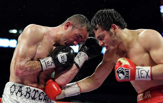 Marco Antonio Rubio (left) and  Julio Cesar Chavez, Jr. exchange punches during the 12th round of their WBC middleweight title fight Saturday Feb. 4, 2012 at the Alamodome. Chavez won the fight. Photo: EDWARD A. ORNELAS, Express-News / © SAN ANTONIO EXPRESS-NEWS (NFS)