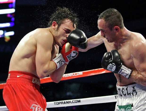 Julio Cesar Chavez, Jr. (left) is hit by Marco Antonio Rubio during the seventh round of their WBC middleweight title fight Saturday Feb. 4, 2012 at the Alamodome. Photo: EDWARD A. ORNELAS, Express-News / © SAN ANTONIO EXPRESS-NEWS (NFS)