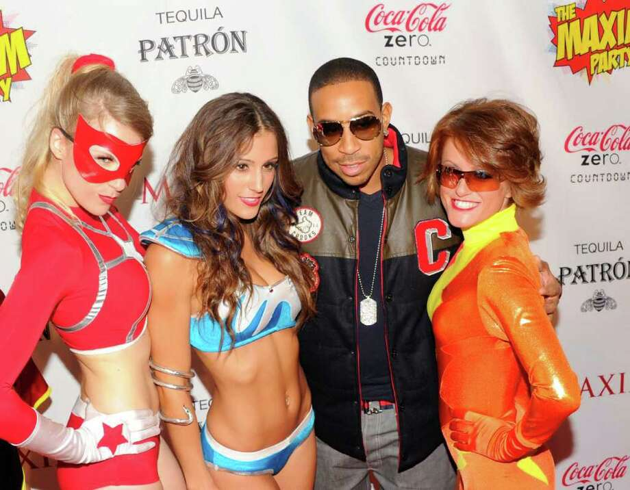 INDIANAPOLIS, IN - FEBRUARY 04:  Rapper Ludacris and MAXIM superheroes attend Patron Presents The MAXIM Party Featuring Coca Cola Zero Countdown at Indiana State Fairgrounds on February 4, 2012 in Indianapolis, Indiana. Photo: Andrew H. Walker, Getty Images For Maxim / 2012 Getty Images