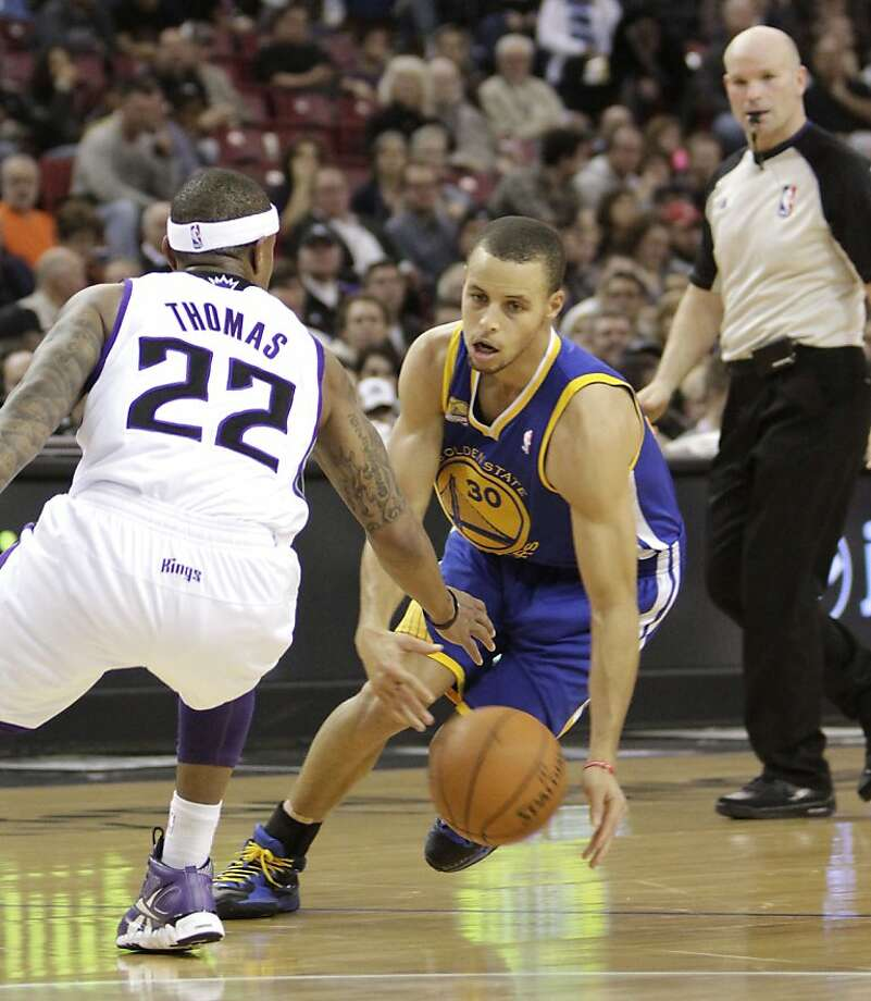 Golden State Warriors guard Stephen Curry, right, eludes Sacramento Kings guard Isaiah Thomas during the second quarter of an NBA basketball game in Sacramento, Calif., Saturday, Feb. 4, 2012.  (AP Photo/Rich Pedroncelli) Photo: Rich Pedroncelli, Associated Press