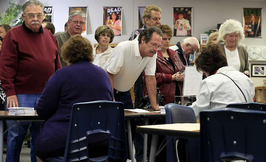 Hundreds of people gather to listen and vote in the Nevada GOP caucus,Saturday February 4, 2012, held the Bob Miller Middle School  in a suburb of Las Vegas, Nevada. Photo: Lacy Atkins, The Chronicle
