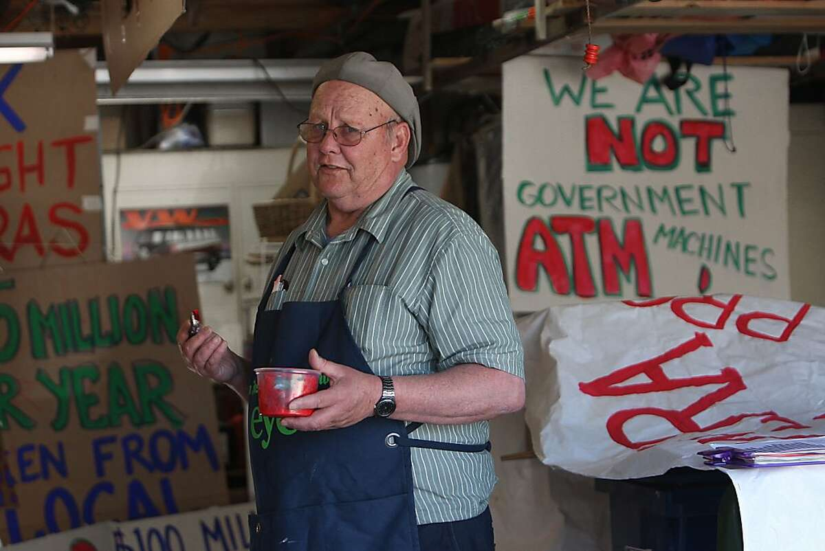 Roger Jones making protest signs in his basement at home in Fremont, Calif., Friday, February 3, 2012. California's red light camera citations are the most expensive in the world ($480), and a new group in Fremont is dedicated to reducing them.