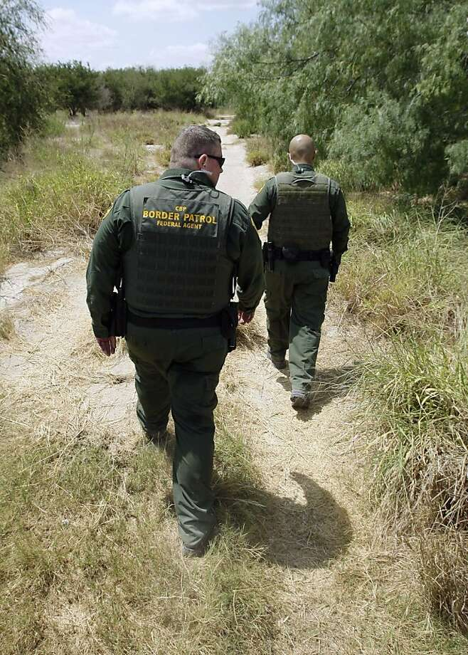 In this June 8, 2011 file photo U.S. Customs and Border Patrol agents patrol along the Rio Grande near Penitas, Texas. Most illegal border crossers are apprehended along the 2,000-mile long Mexican border in California, Arizona, New Mexico, and Texas. In the budget year that ended in September, 18,506 agents on that border made a combined 327,577 apprehensions, an average of nearly 18 apprehensions per agent, and spent about $283 million on overtime an according to Associated Press analysis of agency records. Photo: Eric Gay, Associated Press