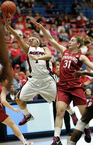 Arizona's Davellyn Whyte (1) shoots for two while being guarded by Stanford's Toni Kokenis (31) during the first half of an NCAA college basketball game at McKale Center in Tucson, Ariz., Saturday, Feb. 4, 2012. Stanford won 91-51. Photo: John Miller, Associated Press
