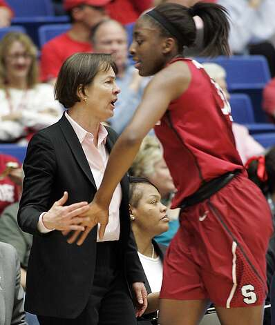 Stanford's head coach Tara VanDerveer congratulates Nnemkadi Ogwumike, right, as she comes off the court agaisnt Arizona during the first half of an NCAA college basketball game at McKale Center in Tucson, Ariz., Saturday, Feb. 4, 2012. Stanford won 91-51. Photo: John Miller, Associated Press