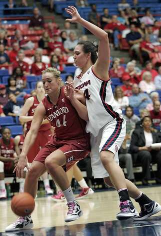 Stanford's Joslyn Tinkle (44) drives against Arizona's Aley Rohde, right, under the basket during the second half of an NCAA college basketball game at McKale Center in Tucson, Ariz., Saturday, Feb. 4, 2012. Stanford won 91-51. Photo: John Miller, Associated Press