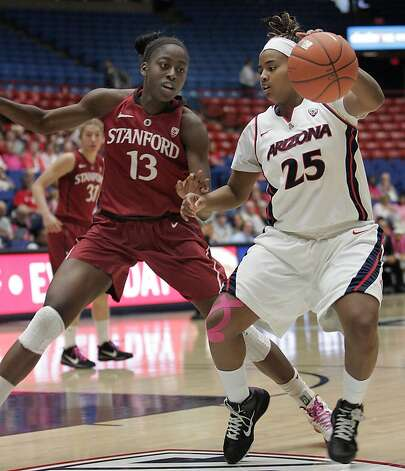 Arizona's Reiko Thomas (25) works the ball against Stanford's Chiney Ogwumike (13) during the first half of an NCAA college basketball game at McKale Center in Tucson, Ariz., Saturday, Feb. 4, 2012. Stanford won 91-51. Photo: John Miller, Associated Press