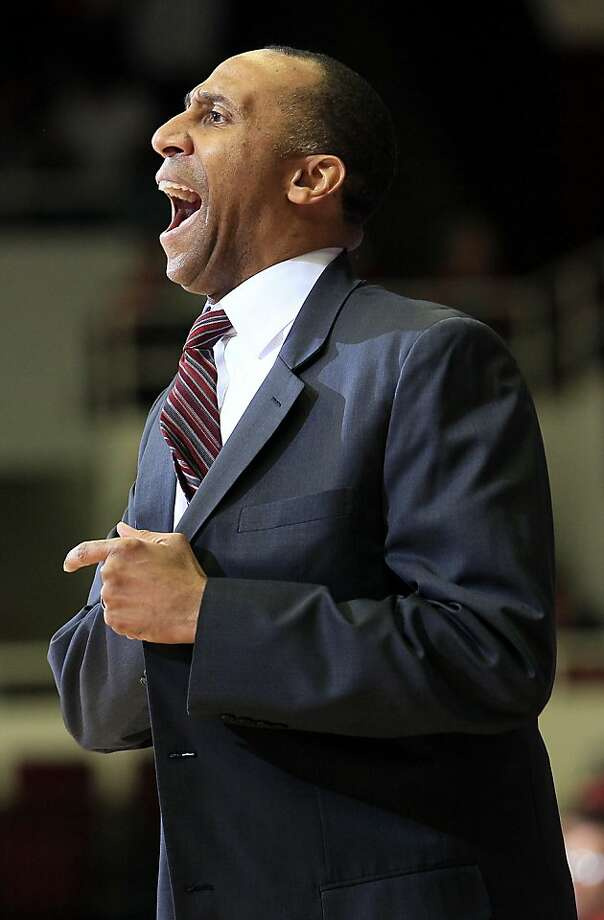 Stanford head coach Johnny Dawkins yells during the first half of an NCAA college basketball game against Arizona in Stanford, Calif., Saturday, Feb. 4, 2012. Arizona won 56-43. Photo: Jeff Chiu, Associated Press