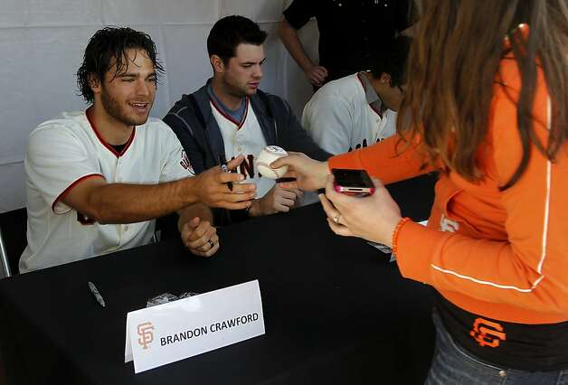 Players Brandon Crawford and Brandon Belt sign autographs for fans who waited in long lines at the annual Giants FanFest at AT&T Park in San Francisco, Calif. on Saturday, Feb. 4, 2012. Photo: Paul Chinn, The Chronicle
