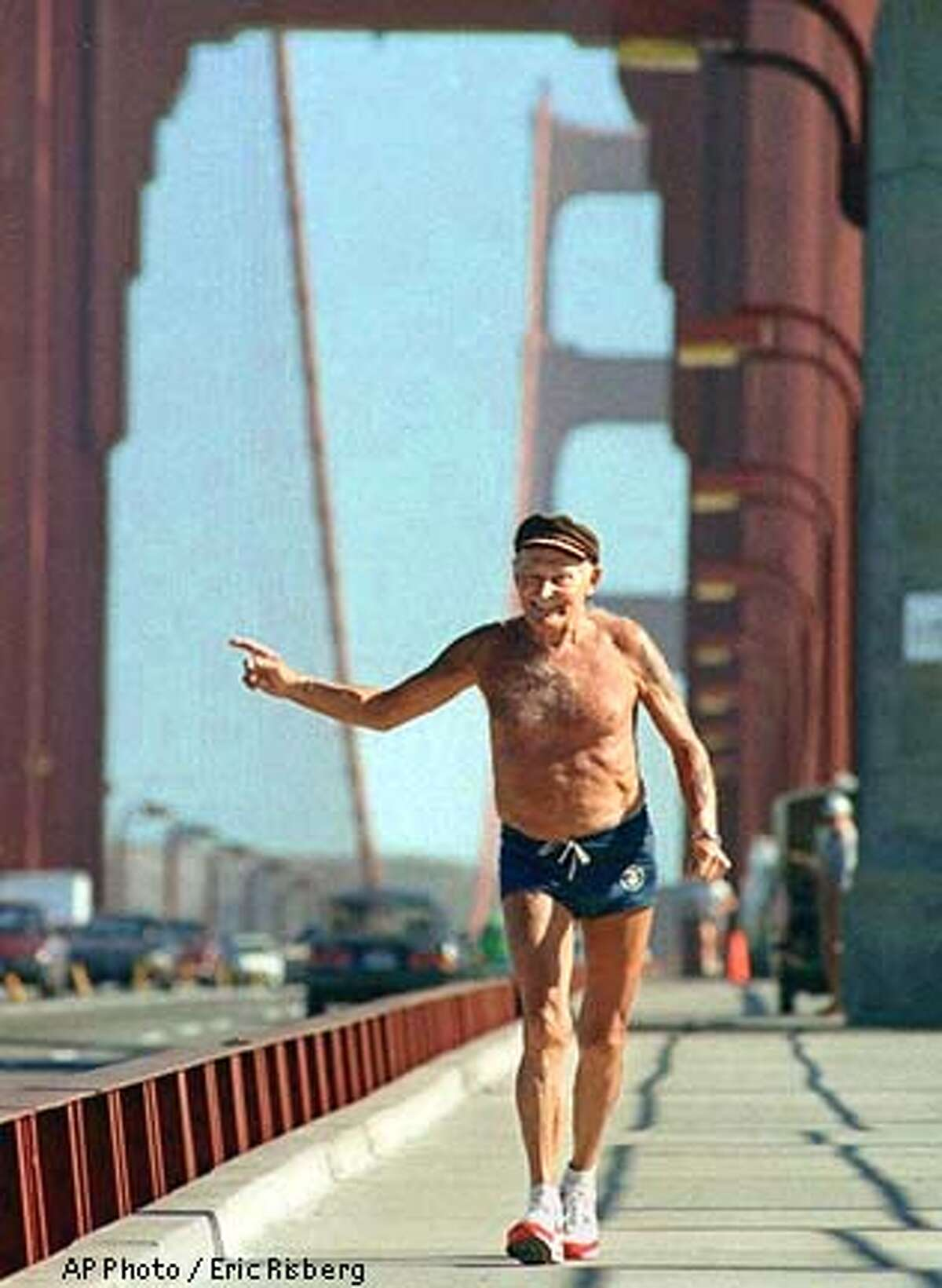 FILE--Octogenarian runner Walt Stack waves at passersby while running across the Golden Gate Bridge in San Francisco in June 1988. Stack, who used to run daily across the bridge to Sausalito and back to San Francisco, died Thursday, Jan. 19, 1995. (AP Photo/Eric Risberg)