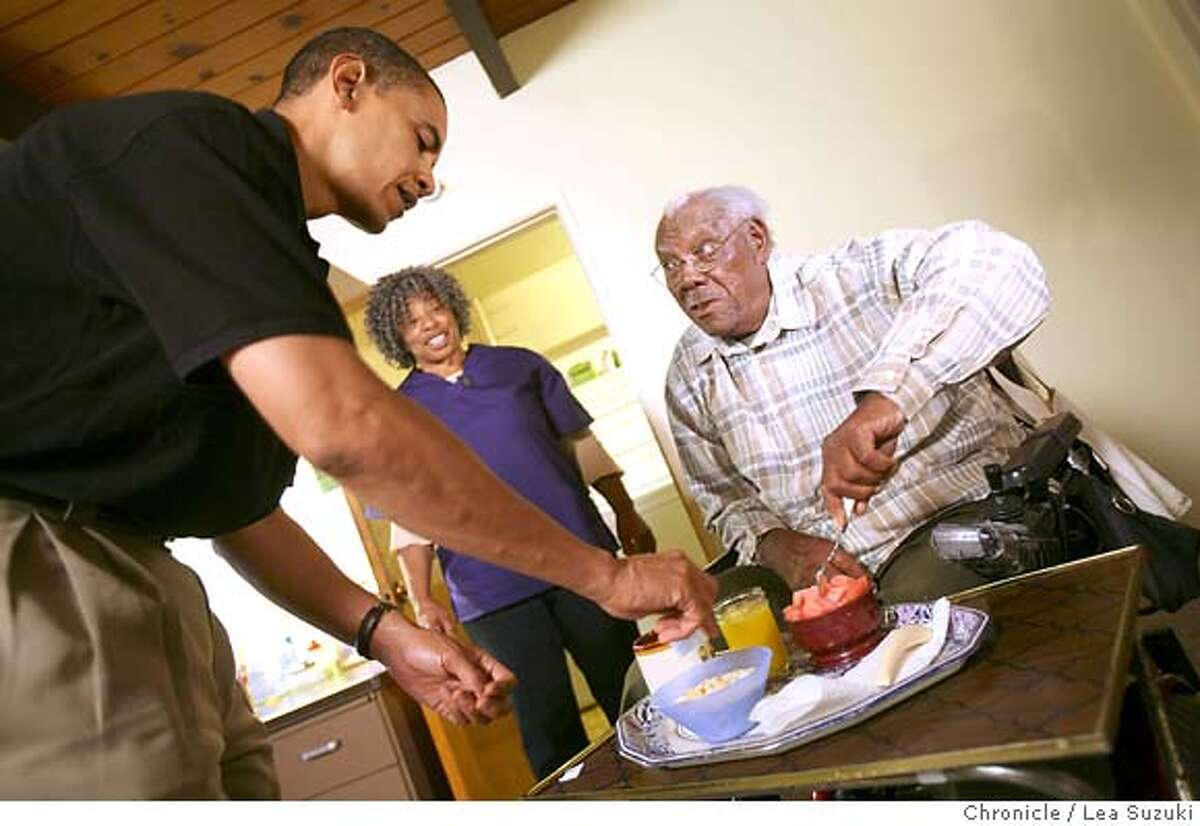 From left:Barack Obama, Pauline Beck and John Thornton. Obama sprinkles sugar on Thornton's cereal and watermelon while spending the day working with Pauline Beck during the Walk a Day in My Shoes program. Senator Barack Obama spends the morning with Pauline Beck, a home health care worker, first meeting her at her home in Alameda and then going to her work where she cares for John Thornton in Oakland as part of the Walk a Day in My Shoes program. Photo taken on 080807 in Alameda, CA. Photo by Lea Suzuki/ The Chronicle (Nadia Conners, Leila Conners Petersen)cq