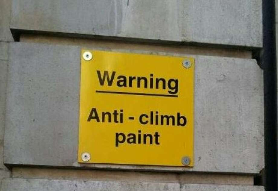 In London, the power of words may be enough to dissuade potential building climbers. Photo: Youmika, Signspotting.com