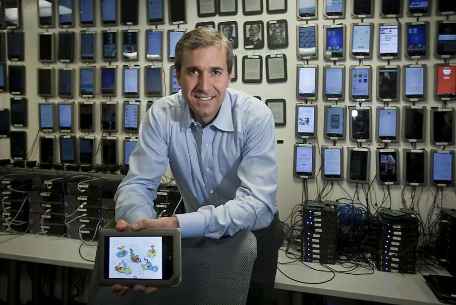 William Lynch, chief executive of Barnes & Noble, with a wall full of e-readers at a company site, where 300 employees are aiming to build the company's digital side, in Palo Alto, Calif., Jan. 24, 2012. Barnes & Noble, once viewed as the brutal capitalist of the book trade, isn't expected to disappear overnight, but there is worry that it might slowly wither as readers embrace e-books. (Peter DaSilva/The New York Times) -- PHOTO MOVED IN ADVANCE AND NOT FOR USE - ONLINE OR IN PRINT - BEFORE JAN. 29, 2012. Photo: Peter DaSilva, New York Times