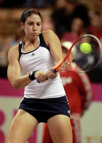 Christina McHale returns a ball to Darya Kustova, of Belarus, during a first-round Fed Cup tennis match in Worcester, Mass., Sunday, Feb. 5, 2012. Photo: AP