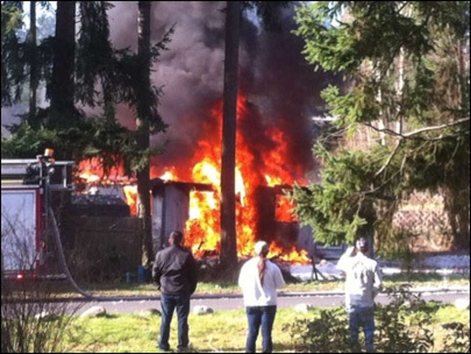 Flames pour from the home of Josh Powell after the afternoon explosion on Sunday, Feb. 5, 2012. Photo: KOMO-TV Photo