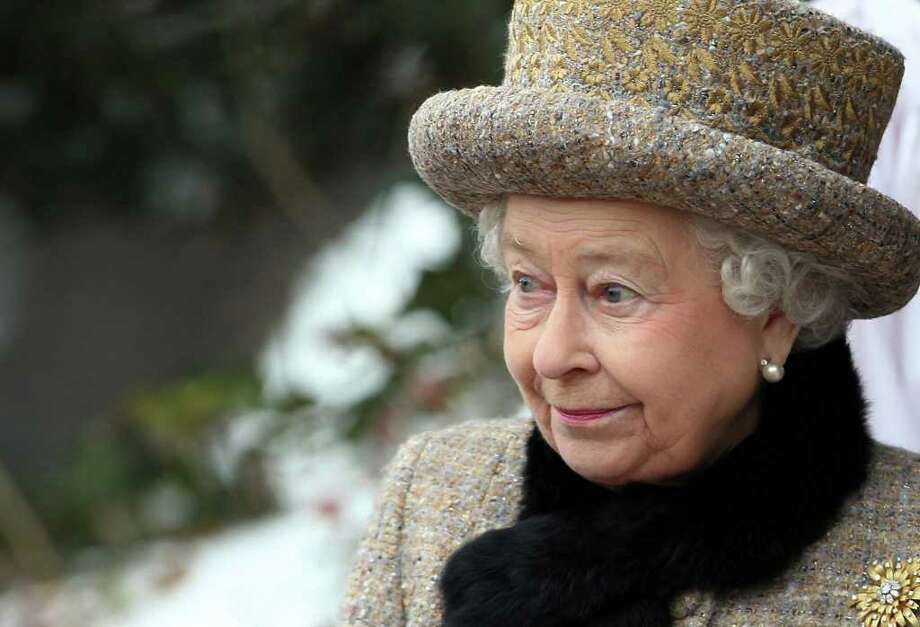 Britain's Queen Elizabeth II attends the church of St Peter and St Paul at West Newton, eastern England, Sunday Feb. 5, 2012. The queen braved the cold and snow to attend church Sunday on the eve of her Diamond Jubilee anniversary. The 85-year-old monarch marks 60 years on the throne on Monday. The anniversary will be marked by a series of regional, national and international events throughout 2012.  Elizabeth ascended the throne when her father, George VI, died on Feb. 6, 1952. She is the longest-serving monarch after Queen Victoria, who reigned for more than 63 years. (AP Photo/PA, Chris Radburn) UNITED KINGDOM OUT  NO SALES  NO ARCHIVE Photo: Chris Radburn / PA