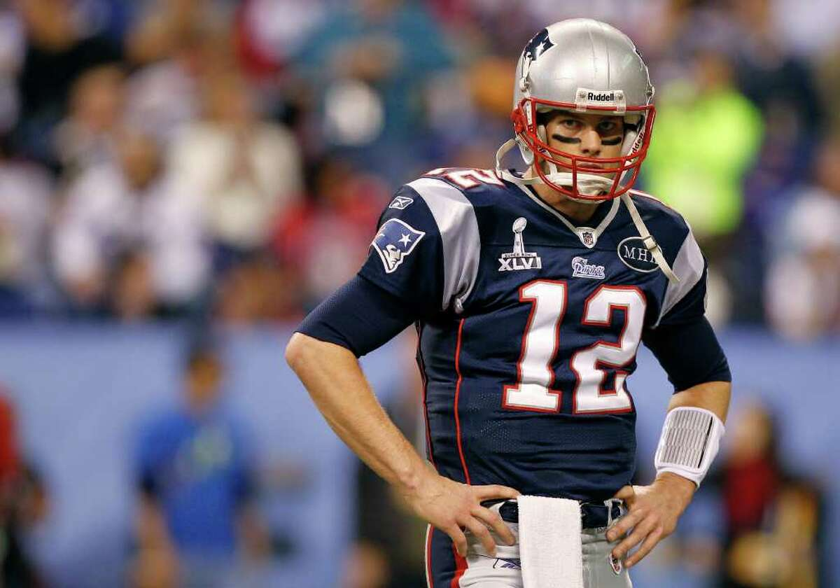 New England Patriots quarterback Tom Brady looks across the field during warm ups before the NFL Super Bowl XLVI football game against the New York Giants Sunday, Feb. 5, 2012, in Indianapolis. (AP Photo/Paul Sancya)