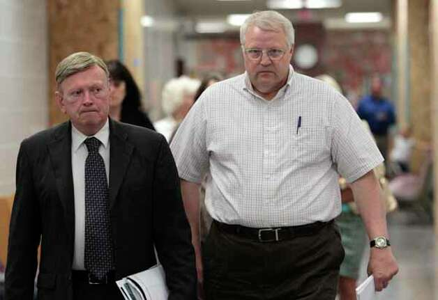 Chuck Cox, father of Susan Cox Powell, right, walks with his attorney Steve Dowling as they head to a court hearing Tuesday, Aug. 23, 2011, in Tacoma, Wash. Josh Powell, wife of Susan Cox Powell, requested a restraining order against Cox. Susan Cox Powell has been missing for two years and Josh Powell is under a cloud of suspicion in her disappearance. (AP Photo/Elaine Thompson) Photo: Elaine Thompson, Associated Press / AP