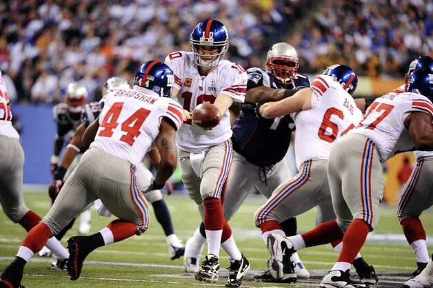 Quarterback Eli Manning (10) of the New York Giants hands off to running back Ahmad Bradshaw (44) of the New York Giants during the first quarter of Super Bowl XLVI at Lucas Oil Stadium in Indianapolis, Indiana, Sunday, February 5, 2012. (Lionel Hahn/Abaca Press/MCT) Photo: Lionel Hahn, McClatchy-Tribune News Service / Abaca Press
