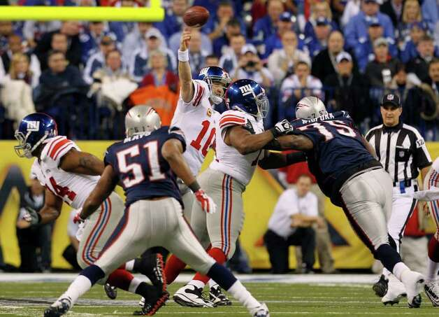 New York Giants quarterback Eli Manning passes against the New England Patriots during the first half of the NFL Super Bowl XLVI football game, Sunday, Feb. 5, 2012, in Indianapolis. (AP Photo/Jeff Roberson) Photo: Jeff Roberson, Associated Press / AP