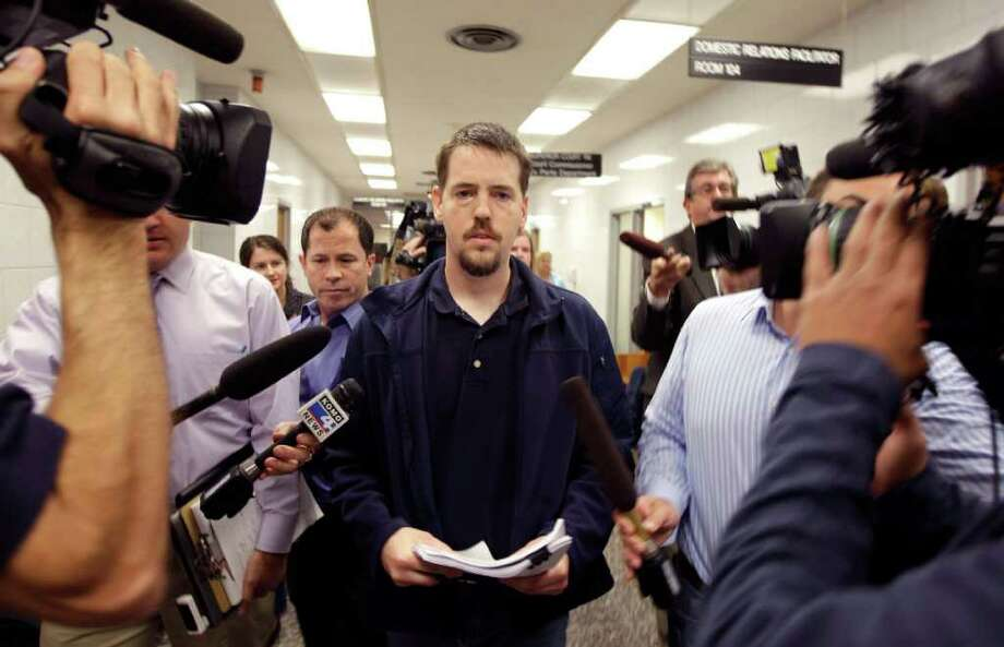 FILE - In this Sept. 23, 2011 file photo, Josh Powell is surrounded by reporters as he leaves a Pierce County courtroom in Tacoma, Wash. An explosion at a Washington state home has killed Powell, the husband of missing Utah woman Susan Powell, and their two young sons, officials said Sunday, Feb. 5, 2012. (AP Photo/Ted S. Warren, File) Photo: Ted S. Warren