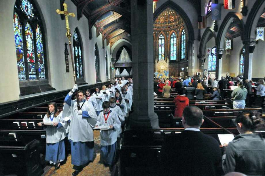 The processional makes its way to the altar of St. Peter's Episcopal Church during a service to begin the church's year long celebration of its 300th anniversary,  on Sunday Feb. 5, 2012 in Albany, NY.    (Philip Kamrass / Times Union ) Photo: Philip Kamrass / 00016254A