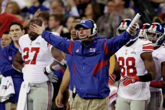 INDIANAPOLIS, IN - FEBRUARY 05:  Head coach Tom Coughlin of the New York Giants reacts to a play  during the first half against the New England Patriots during Super Bowl XLVI at Lucas Oil Stadium on February 5, 2012 in Indianapolis, Indiana. Photo: Elsa, Getty Images / 2012 Getty Images