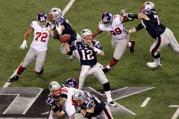 INDIANAPOLIS, IN - FEBRUARY 05:  Quarterback Tom Brady #12 of the New England Patriots throws a pass during the second quarter against the New York Giants during Super Bowl XLVI at Lucas Oil Stadium on February 5, 2012 in Indianapolis, Indiana. Photo: Joe Robbins, Getty Images / 2012 Getty Images