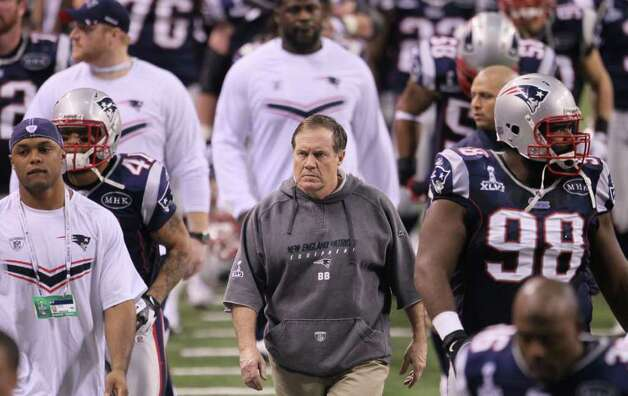 INDIANAPOLIS, IN - FEBRUARY 05:  Head coach Bill Belichick of the New England Patriots walks with his players to the locker room at halftime against the New York Giants in Super Bowl XLVI at Lucas Oil Stadium on February 5, 2012 in Indianapolis, Indiana. Photo: Jeff Gross, Getty Images / 2012 Getty Images