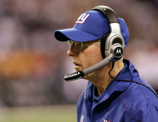 New York Giants head coach Tom Coughlin looks on during the first half of the NFL Super Bowl XLVI football game against the New England Patriots Sunday, Feb. 5, 2012, in Indianapolis. (AP Photo/Eric Gay) Photo: Eric Gay, Associated Press / AP