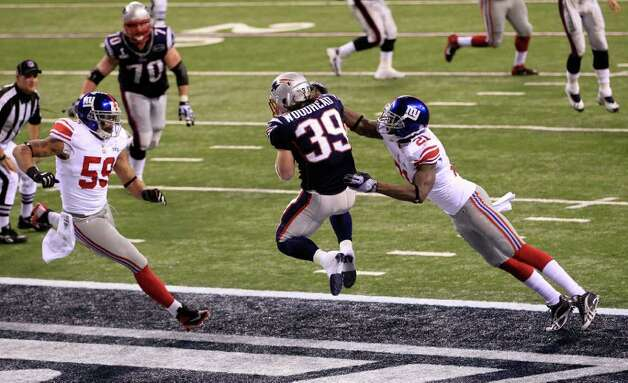 INDIANAPOLIS, IN - FEBRUARY 05:  Danny Woodhead #39 of the New England Patriots catches a three yard touchdown pass from Tom Brady #12 in the second quarter against Kenny Phillips #21 of the New York Giants during Super Bowl XLVI at Lucas Oil Stadium on February 5, 2012 in Indianapolis, Indiana. Photo: Chris Trotman, Getty Images / 2012 Getty Images
