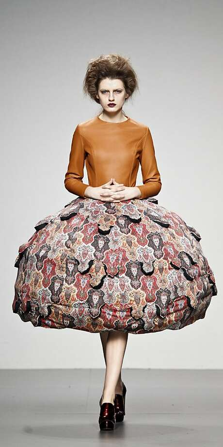 A model displays an Autumn/Winter design by Leandro Cano during the Ego for young designers of the Madrid's Mercedes Benz Fashion Week, in Madrid, Sunday, Feb. 5, 2012. (AP Photo/Daniel Ochoa de Olza) Photo: Daniel Ochoa De Olza, Associated Press