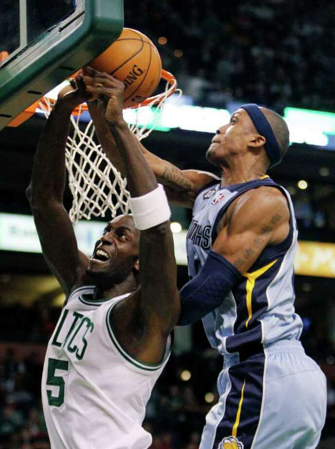 Memphis Grizzlies' Dante Cunningham, right, fouls Boston Celtics' Kevin Garnett (5) in the second quarter of an NBA basketball game in Boston, Sunday, Feb. 5, 2012. (AP Photo/Michael Dwyer) Photo: Michael Dwyer