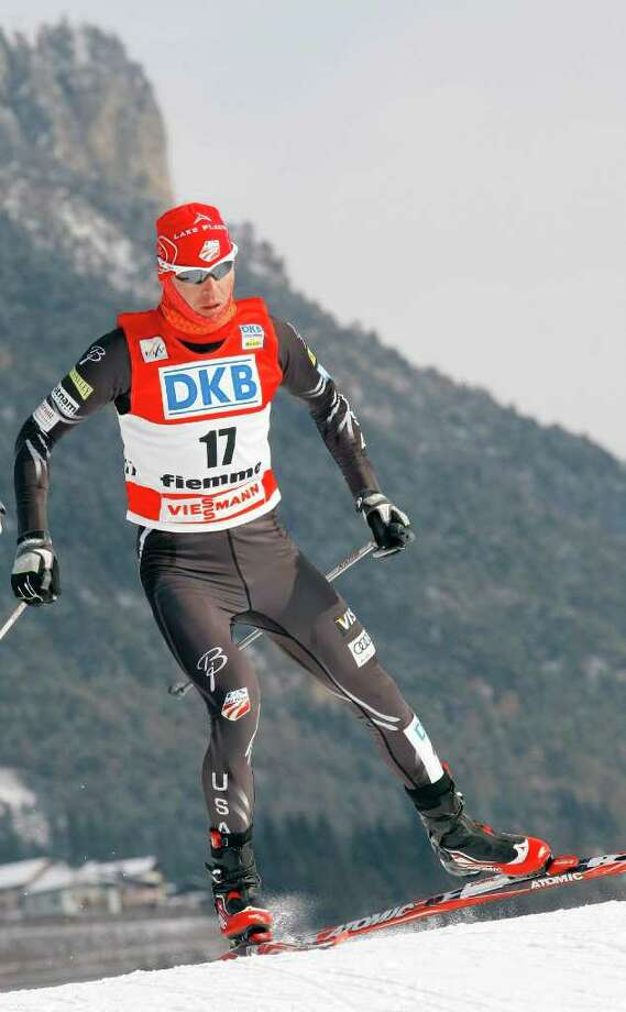 Bill Demong, of the United States, races to the third place, during a World Cup Nordic Combined, in Val di Fiemme, Italy, Sunday, Feb. 5, 2012. (AP Photo/Armando Trovati) Photo: Armando Trovati / AP