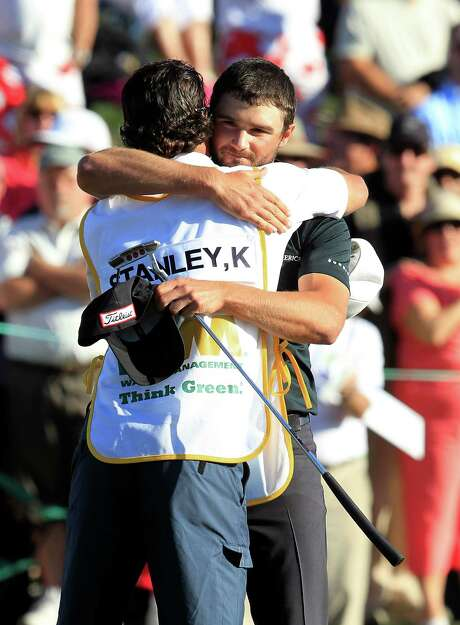 Kyle Stanley (right) hugs caddie Brett Waldman after putting out on the 18th hole to complete his final-round 65 at the Phoenix Open. Photo: Ross D. Franklin, AP / AP