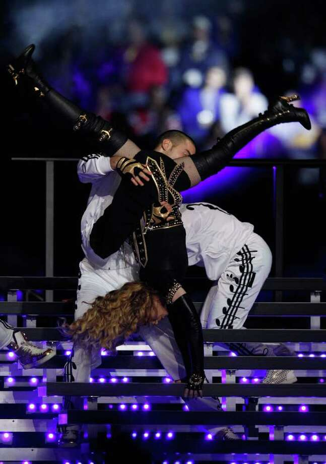 INDIANAPOLIS, IN - FEBRUARY 05:  Singer Madonna performs during the Bridgestone Super Bowl XLVI Halftime Show at Lucas Oil Stadium on February 5, 2012 in Indianapolis, Indiana. Photo: Rob Carr, Getty Images / 2012 Getty Images
