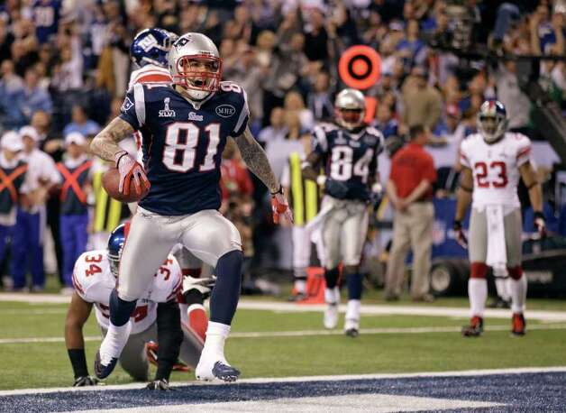 New England Patriots tight end Aaron Hernandez (81) reacts after catching a 12-yard touchdown pass during the second half of the NFL Super Bowl XLVI football game against the New York Giants, Sunday, Feb. 5, 2012, in Indianapolis. (AP Photo/Marcio Jose Sanchez) Photo: Marcio Jose Sanchez, Associated Press / AP
