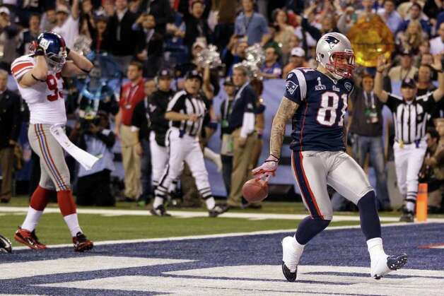 New England Patriots tight end Aaron Hernandez (81) reacts after catching a 12-yard touchdown pass during the second half of the NFL Super Bowl XLVI football game against the New York Giants, Sunday, Feb. 5, 2012, in Indianapolis. (AP Photo/Matt Slocum) Photo: Matt Slocum, Associated Press / AP