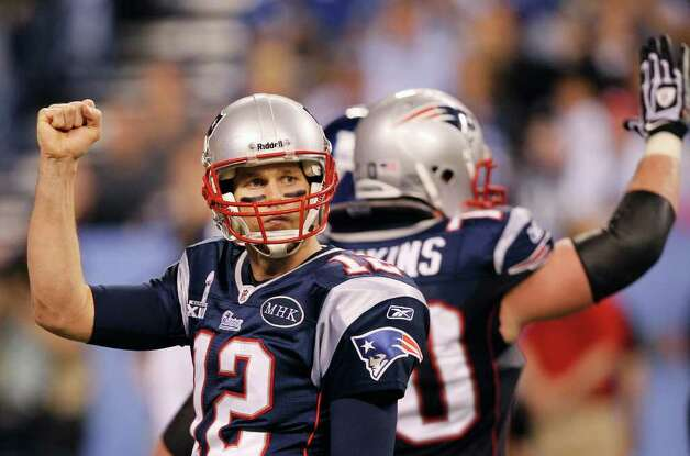 New England Patriots quarterback Tom Brady reacts after throwing a touchdown pass during the second half of the NFL Super Bowl XLVI football game against the New York Giants, Sunday, Feb. 5, 2012, in Indianapolis. (AP Photo/Paul Sancya) Photo: Paul Sancya, Associated Press / AP