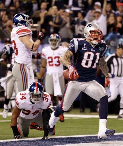 New England Patriots tight end Aaron Hernandez (81) celebrates his touchdown against the New York Giants during the second half of the NFL Super Bowl XLVI football game, Sunday, Feb. 5, 2012, in Indianapolis. (AP Photo/Matt Slocum) Photo: Matt Slocum, Associated Press / AP