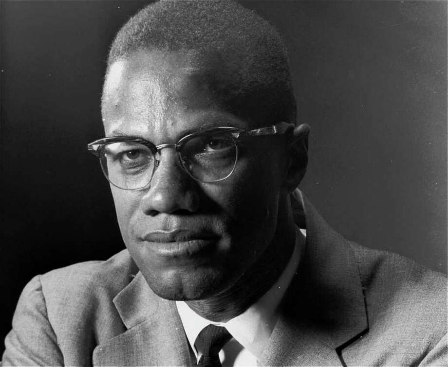 "** FILE ** Malcolm X, the Black Muslim leader, is photographed in New York  on March 5, 1964.  Malcolm X was assassinated in 1965 and 32 years later his wife Betty Shabazz was killed in a fire set by their grandson, Malcolm's namesake.   Ilyasah Shabazz, says she and her five sisters don't want pity and, in fact, had a sheltered upbringing. Ilyasah says in her new memoir, ""Growing Up X,"" that people are surprised when they learn ""how normal my childhood was, how mainstream and privileged and integrated and utterly American."" (AP Photo/Eddie Adams)  HOUCHRON CAPTION (05/02/1998)(11/20/1998)(12/27/1998) (05/22/1999)(02/21/2001)(01/08/2003):  Malcolm X.  HOUCHRON CAPTION  (09/16/2003):  The FBI probed communist connections to Muslim groups joined by Malcolm X. Photo: EDDIE ADAMS / AP"