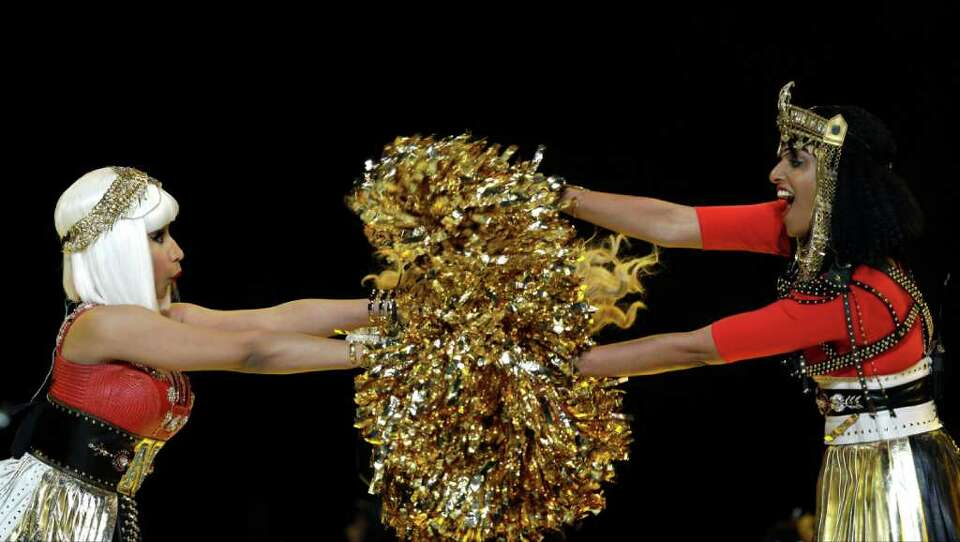 Nicki Minaj, left, and M.I.A. perform during halftime of the NFL Super Bowl XLVI football game betwe