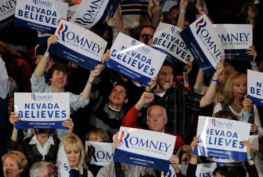 LAS VEGAS, NV - FEBRUARY 04:  Supporters wave signs after the Nevada caucus race was called for Republican presidential candidate, former Massachusetts Gov. Mitt Romney during an election party at the Red Rock Casino February 4, 2012 in Las Vegas, Nevada. According to early results, Romney defeated former Speaker of the House Newt Gingrich, former U.S. Sen. Rick Santorum and U.S. Rep. Ron Paul (R-TX) to win the Nevada caucus.  (Photo by Ethan Miller/Getty Images) Photo: Ethan Miller / 2012 Getty Images