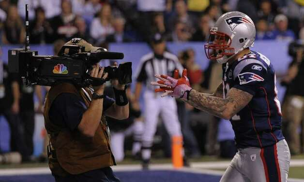 Aaron Hernandez (R) of the New England Patriots celebrates his touchdown early in the second half of Super Bowl XLVI against the New York Giants on February 5, 2012 at Lucas Oil Stadium in Indianapolis, Indiana. AFP PHOTO / TIMOTHY A. CLARY Photo: TIMOTHY A. CLARY, AFP/Getty Images / AFP