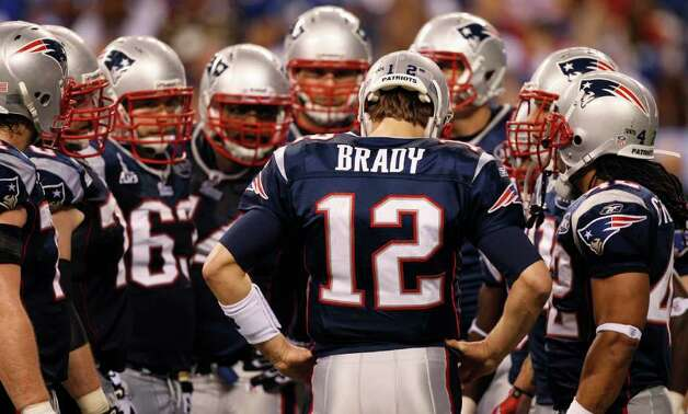 New England Patriots quarterback Tom Brady leads a huddle during the second half of the NFL Super Bowl XLVI football game against the New York Giants, Sunday, Feb. 5, 2012, in Indianapolis. (AP Photo/Paul Sancya) Photo: Paul Sancya, Associated Press / AP