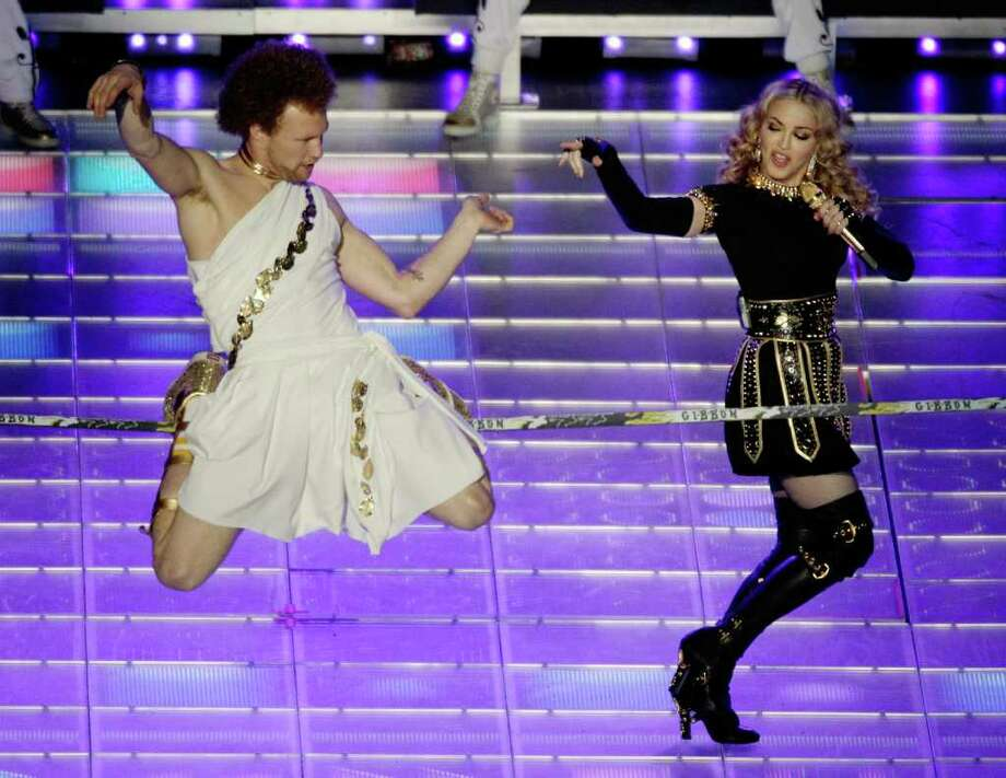 Madonna performs during halftime of the NFL Super Bowl XLVI football game between the New York Giants and the New England Patriots, Sunday, Feb. 5, 2012, in Indianapolis. (AP Photo/Charlie Riedel) Photo: Charlie Riedel