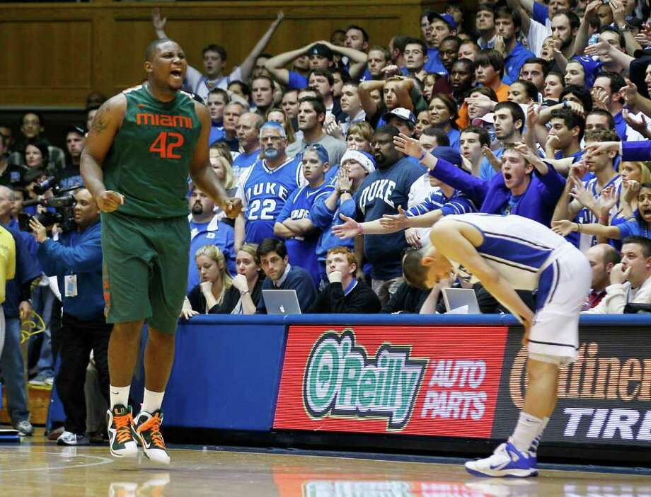 Duke's Austin Rivers reacts at right while Miami's Reggie Johnson (42) celebrates following an NCAA college basketball game in Durham, N.C., Sunday, Feb. 5, 2012. Miami won 78-74 in overtime. (AP Photo/Gerry Broome) Photo: Gerry Broome