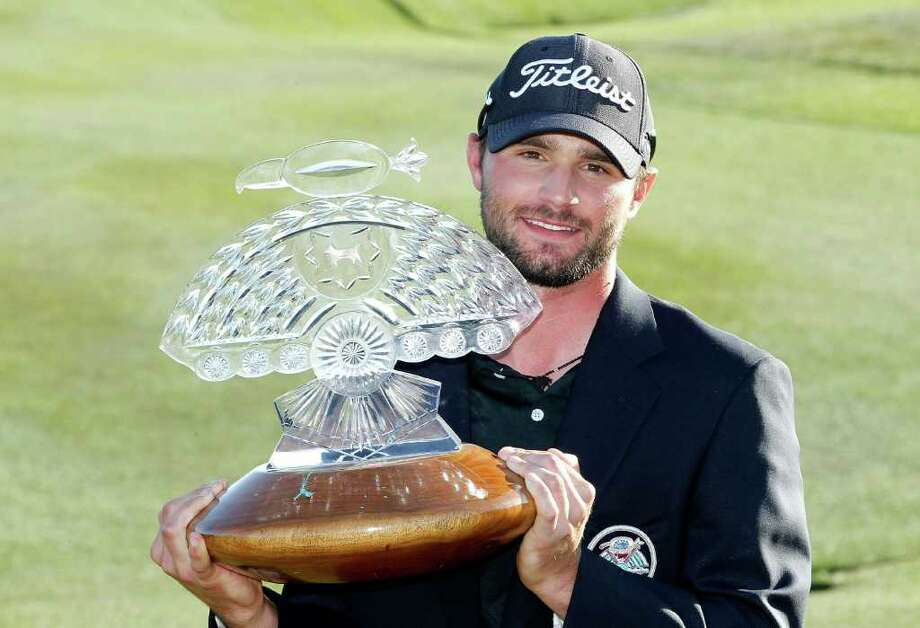 Kyle Stanley holds the championship trophy after winning the Phoenix Open golf tournament Sunday, Feb. 5, 2012, in Scottsdale, Ariz.  Stanley came from behind to win the tournament, scoring a final round 65, for a tournament total of 15-under par.(AP Photo/Ross D. Franklin) Photo: Ross D. Franklin